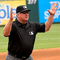 Bill Miller umpire signals a foul ball in Texas in 2014.jpg