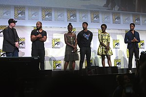 Black Panther (film) - (L:R) Producer Kevin Feige, director Ryan Coogler, and actors Lupita Nyong'o, Michael B. Jordan, Danai Gurira, and Chadwick Boseman promoting Black Panther at the 2016 San Diego Comic-Con International.
