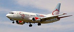Bmibaby - Boeing 737-300 landing at Barcelona El Prat Airport in 2010