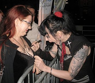 Autograph - Singer Anja Orthodox autographing the body of one of her fans