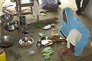 Breakfast making in adivasi village, Umaria district, India