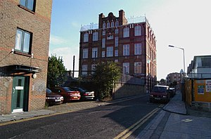 Durward Street - Durward Street, looking west, in 2006. Mary Ann Nichols's body was found approximately at the nearer end of the low brick wall.  The Board School, extant in 1888, can be seen in the background...