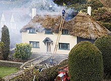 Burning house, Bekonscot.JPG
