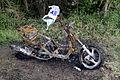 Burnt motor scooter at bridge over Cripsey Brook at Moreton village, Essex, England.jpg