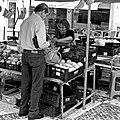 Buying grapes at the market (21364433011).jpg