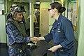 CAPT Heidi Agle shakes hands with JMSDF sailor, 2015.jpg