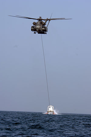 Minesweeping - An MH-53E of the United States Navy towing an MK105 mine sweeping sled.