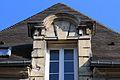 Caen 142 rue Saint Pierre lucarne datée 1593.JPG