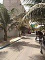 Calèche dans une ruelle à Dakar.jpg