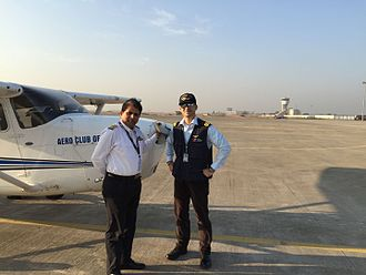 Flight instructor - A Chief Flying Instructor and Commercial Pilot at Surat Airport in India showing variation in pilot uniforms.