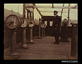 Captain, possibly W L Smith, standing on the bridge of a steamship (7647081976).jpg