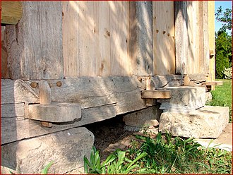 Sill plate - Unusual sill framing in a granary of half-timber construction. Long tenons project through the sill plate. Timber sills can span gaps in a foundation.