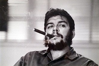 """Guevarism - Ernesto """"Che"""" Guevara smoking a cigar in Havana, Cuba, 1963"""