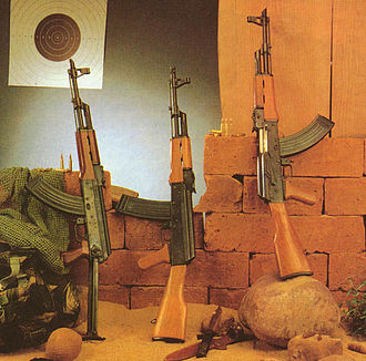 Type 56 assault rifle - Type 56S-1 (left), Type-84S (center), and Type-56S (right). Note that the Type 56 rifles in this image have been fitted with the distinctive slant compensator of the AKM, a feature not found on the original Type 56
