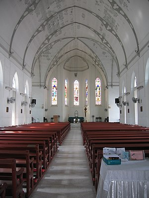 Church of Saints Peter and Paul, Singapore - The church's interior showing the nave, altar and stained glass windows.