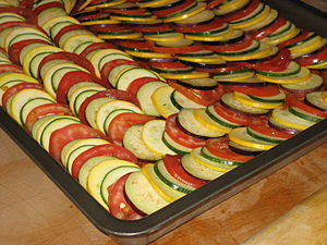 Confit byaldi - Vegetable rounds arranged on a baking tin