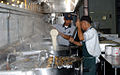 Contract worker prepares food at Guantanamo -d.jpg