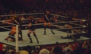 The Corre - The four members of The Corre using their superior numbers for an in-ring attack on John Cena and The Rock
