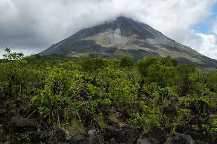 Arenal in 2014, viewed from the old 1968 lava flow. CostaRica Arenal Volcano 1968Flow (pixinn.net).jpg
