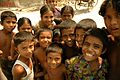 Crowd of smiling children in Bangladesh.jpg