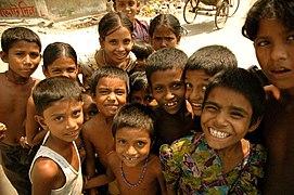 Crowd of smiling children in Bangladesh.jpg