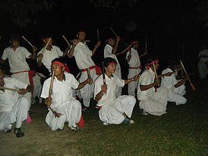 Laathi nach - tharu boys performing stick dance