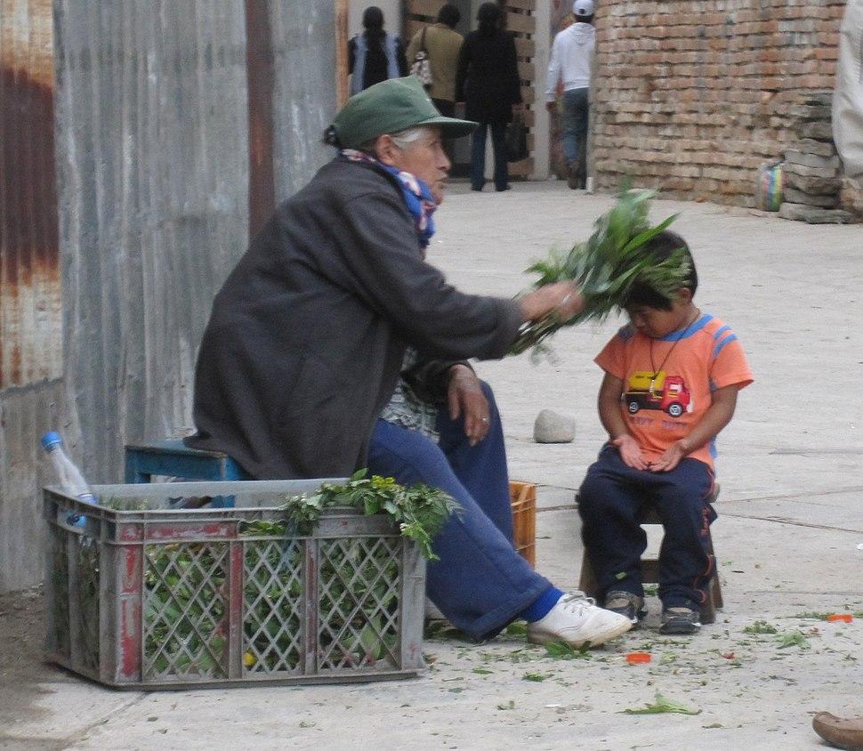 Curandera performing a limpieza