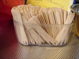 Chip fork - Two-pronged wooden chip forks in a container