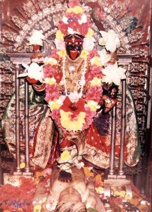 Swami Vivekananda's prayer to Kali at Dakshineswar - The presiding temple deity, Maa Bhavatarini, Mother Goddess Kali, with a foot over Shiva.