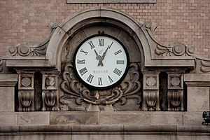 Dalian - An old clock on a heritage building near the port
