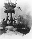 Damage to the smokestack and signal bridge of USS Hornet (CV-8) on 26 October 1942 (80-G-40300).jpg