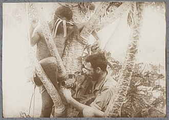 Kokoda Front Line! - Image: Damien with Papuan Assistant filming Kokoda Front Line, 1942