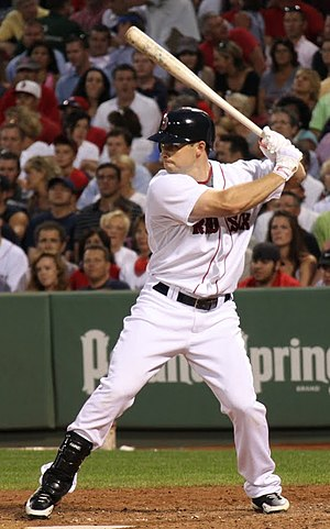 Logos and uniforms of the Boston Red Sox - Daniel Nava wearing the current Red Sox home uniforms.