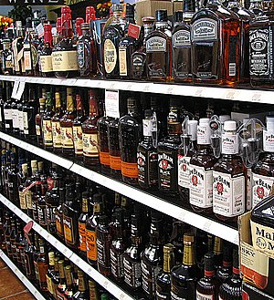 Bourbon whiskeys offered at a liquor store in ...