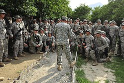 Defense.gov News Photo 100805-F-7552L-211 - Commander of the International Security Assistance Force Gen. David H. Petraeus center U.S. Army talks with U.S. soldiers of the 2nd Battalion
