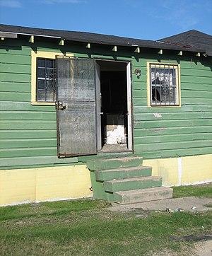 Screen door - Screen door of a flood damaged house, in Desire neighborhood, Upper 9th Ward, New Orleans after Hurricane Katrina