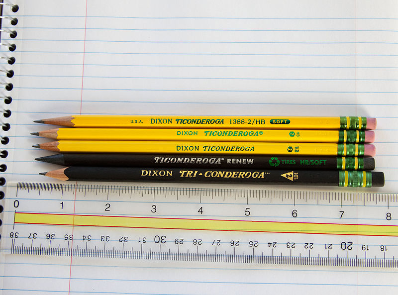 An assortment of pencils manufactured by the Dixon Ticonderoga Company. From top to bottom: The eponymous Dixon Ticonderoga, model number 1388-2 HB Pencil manufactured In U.S.A. circa 2003 (no longer in production); the current (as of March 2010) version of the same pencil, model number 13882, manufactured in China; a current model 13882 pencil from Dixon's Mexico factory (note subtle differences in the yellow laquer finish, ferrule and branding); a Ticonderoga Renew Pencil (model 96220) which utilizes recycled tires in place of wood for its casing; and a Dixon Tri-Conderoga pencil (model 22500) with triangular barrel and rubberized finish. An acrylic ruler with inches displayed upright was placed underneath the pencils for a size reference.