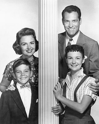 The Donna Reed Show - From the 1958 first season (L-R): Donna Reed as Donna Stone, Carl Betz as Dr. Alex Stone, Paul Petersen as Jeff Stone, and Shelley Fabares as Mary Stone