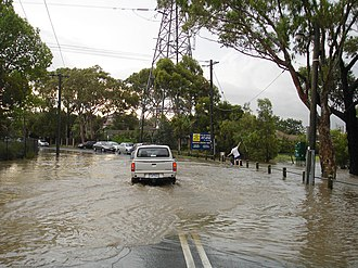 Flash flood - Driving through a flash-flooded road