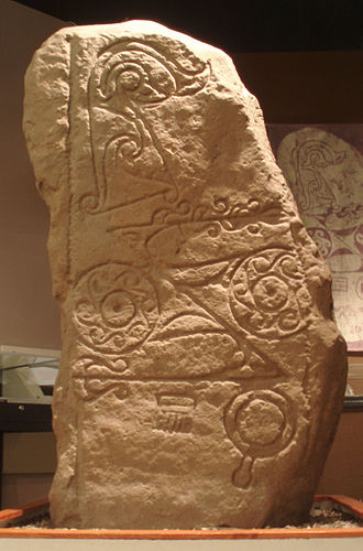 "Pictish stone - The Class I Dunnichen Stone, with Pictish symbols including the ""double disc and Z-rod"" at centre, and ""mirror and comb"" at the bottom."