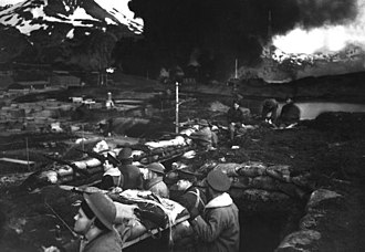 Dutch Harbor Naval Operating Base and Fort Mears, U.S. Army - Japanese attack on Dutch Harbor, June 3, 1942. Group of Marines on the alert between attacks