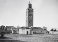 black-and-white photo of the mosque and its minaret-tower, seen from ground level