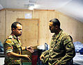 Egyptian army Capt. H.A. Rauof, left, speaks with U.S. Army Capt. Syed Ali, with the Regional Communications Center, Combined Joint Task Force (CJTF), 101st Airborne Division, at the El Salam Egyptian Field 130827-A-YW808-028.jpg