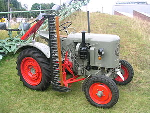 Mower - Eicher tractor with a mid-mounted finger-bar mower