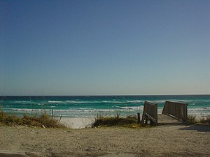 Destin, Florida - An image of a Destin beach, showing the emerald green waters typical of the Emerald Coast