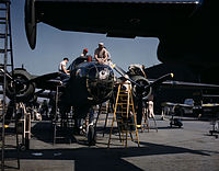 Employees at North American's plant put the finishing touches on another B-25 bomber.jpg