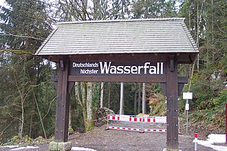 Triberg Waterfalls - A sign at the entrance of the waterfall: Germany's highest waterfall. This claim is actually incorrect, as Germany's highest waterfall is the Rothbachfall, near the Konigssee in Upper Bavaria.