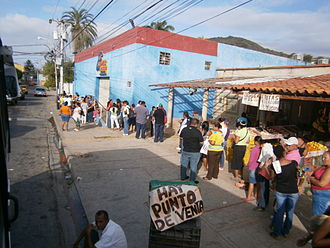 Bolivarian Revolution - Shoppers waiting in line at a Mercal store