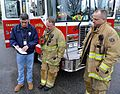FEMA - 43621 - FEMA Community Relations worker speaks with firefighters in Cranston.jpg