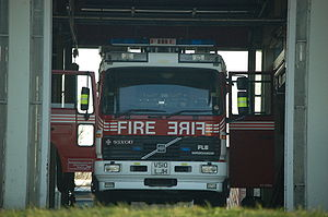"Mirror image - The word ""FIRE"" and its mirror image, ERIF, are displayed on the front of this fire engine"